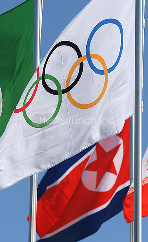The Olympic flag (above) and the North Korean flag waving in the wind in front of the Olympic Stadium in Pyeongchang, South Korea, 07 January 2018. The Pyeongchang 2018 Winter Olympics take place between 09 and 25 February. Photo: Hendrik Schmidt/dpa /MediaPunch ***FOR USA ONLY***