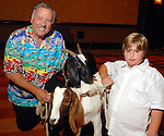 Ed McMahon and Eric Joekel with a couple of goats at the Citizens for Animal Protection owner/pet fashion show at the Hilton Americas Houston Saturday June 06,2009.(Dave Rossman/For the Chronicle)