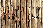 Old farm equipment on barnside.