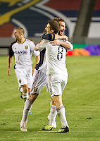CARSON, CA - June 16, 2012: Real Salt Lake midfielder Kyle Beckerman (5) congratulates midfielder Will Johnson (8) on his goal during the Chivas USA vs Real Salt Lake match at the Home Depot Center in Carson, California. Final score Real Salt Lake 3, Chivas USA 0.