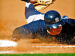 2 March 2009: New York Yankees' right fielder Colin Curtis dives safely back to first during a Spring Training game against the Houston Astros at Osceola County Stadium in Kissimmee, Florida. The teams played to a 5-5, 9-inning tie. Mandatory Photo Credit: Ed Wolfstein Photo