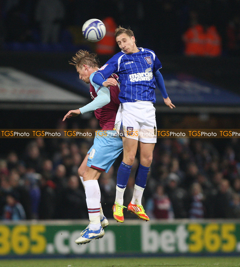 Lee Martin of Ipswich and Jack Collison of West Ham - Ipswich Town vs West Ham United, npower Championship at Portman Road, Ipswich - 31/01/12 - MANDATORY CREDIT: Rob Newell/TGSPHOTO - Self billing applies where appropriate - 0845 094 6026 - contact@tgsphoto.co.uk - NO UNPAID USE..