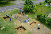HAZLETON, PA - JUNE 30:   Teresa Robbins (L) and Jim Kuzma work at the site of an archaeologic dig June 30, 2014 in Hazleton, Pennsylvania. The team is looking through sites connected with the Lattimer Massacre which occurred in 1897. (Photo by William Thomas Cain/Cain Images)