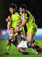 Joe Marchant of Harlequins is tackled to ground by Matt Smith and Maxime Mermoz of Leicester Tigers. Aviva Premiership match, between Harlequins and Leicester Tigers on February 24, 2017 at the Twickenham Stoop in London, England. Photo by: Patrick Khachfe / JMP