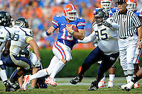 21 November 2009:  FIU defensive tackle Justin West (95) attempts to tackle Florida quarterback Tim Tebow (15) in the first half as the University of Florida Gators defeated the FIU Golden Panthers, 62-3, at Ben Hill Griffin Stadium in Gainesville, Florida.