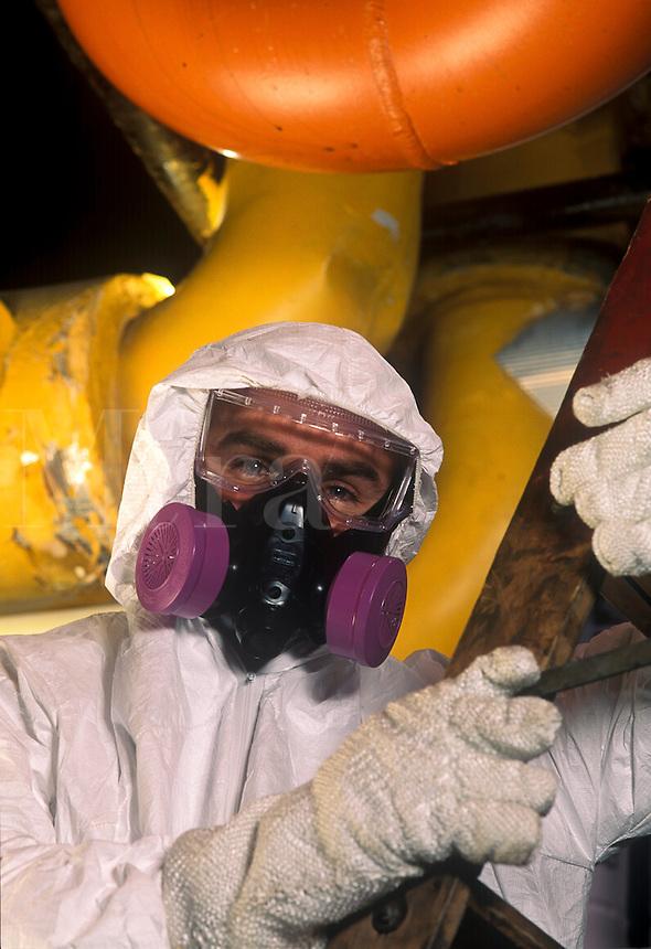 Hazardous material worker in factory.