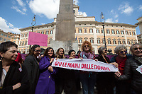 """Fiorella, Singer and Activist. """"Hands Off Women"""". <br /> <br /> Rome, 01/05/2019. This year I will not go to a MayDay Parade, I will not photograph Red flags, trade unionists, activists, thousands of members of the public marching, celebrating, chanting, fighting, marking the International Worker's Day. This year, I decided to show some of the Workers I had the chance to meet and document while at Work. This Story is dedicated to all the people who work, to all the People who are struggling to find a job, to the underpaid, to the exploited, and to the people who work in slave conditions, another way is really possible, and it is not the usual meaningless slogan: MAKE MAYDAY EVERYDAY!<br /> <br /> Happy International Workers Day, long live MayDay!"""