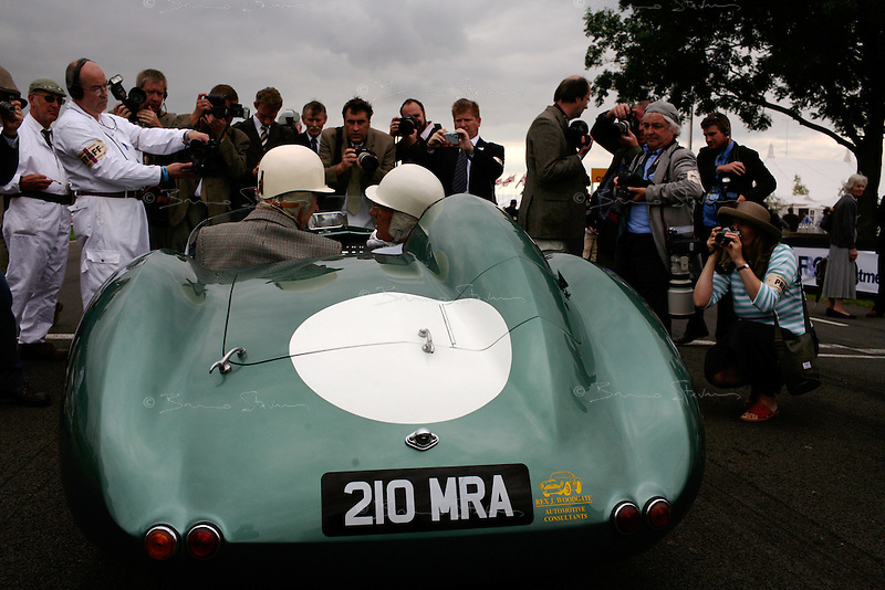 Goodwood Revival, 2007.Three legends: Sir Stirling Moss (at the wheel), Roy Salvadori and Aston Martin! The Goodwood revival is one of the largest historic car races events in the world; 3 days of racing at the highest level with some of the best pilots past and present driving historically important cars to the limit...and sometimes beyond! 110 000 spectators and participants gather in period costumes for a unique event.