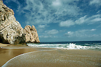 """Land's End rock formations and """"""""lovers beach"""""""" with sand and waves."""
