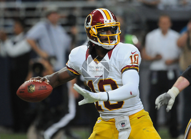 Redskins QB Robert Griffin III looks downfield for a receiver as he lines up a pass in this game against the St. Louis Rams on September 16, 2012.