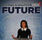 "First lady and honorary chairwoman of Partnership for a Healthier America, Michelle Obama, speaks at the organization's ""Building a Healthier Future Summit"" on Wednesday, Nov. 30, 2011 in Washington, D.C. She was there to advance her efforts to keep kids healthy. (Larry French/AP Images for YMCA)"