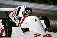 WATKINS GLEN, NY - OCTOBER 5, 1975: James Hunt drives the Hesketh 308C 1/Ford Cosworth during practice for the United States Grand Prix East race at the Watkins Glen Grand Prix Race Course on October 5, 1975 at Watkins Glen, New York.