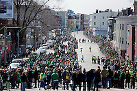 People gather to watch the 2013 annual St. Patrick's Day Parade in South Boston, Boston, Massachusetts, USA.