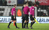Swansea City Manaager Carlos Carvalhal walks off the pitch talking to Referee Bobby Madley after some questionable decisions during the Premier League match between Swansea City and Tottenham Hotspur at the Liberty Stadium, Swansea, Wales on 2 January 2018. Photo by Mark Hawkins / PRiME Media Images.