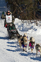 Musher Lachlan Clarke on Long Lake at the Re-Start of the 2011 Iditarod Sled Dog Race in Willow, Alaska.