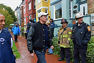 October 30, 2012  (Washington, DC)  D.C. Mayor Vincent Gray (c) tours Hurricane Sandy storm damage in the Bloomingdale neighborhood. This area often floods during rainstorms.    (Photo by Don Baxter/Media Images International)