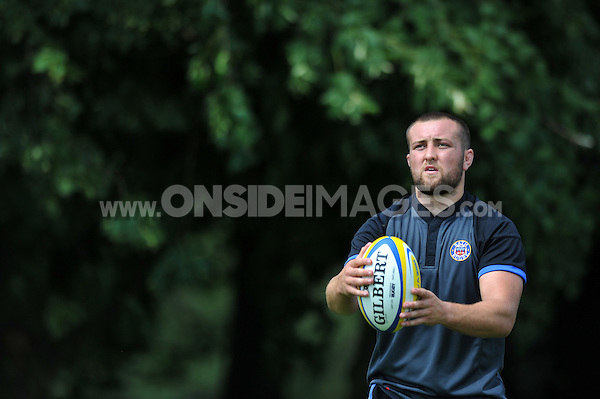 Tom Dunn looks to practise his throwing-in. Bath Rugby pre-season training session on July 18, 2014 at Farleigh House in Bath, England. Photo by: Patrick Khachfe/Onside Images