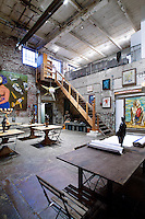 Eclectic seating area with exposed brick walls