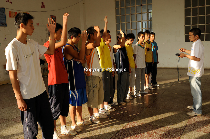 Young boxers are lectured by their coach in Huili Middle School in Sichuan Province, China. The group of young boxers are hoping to make it to become some of China's first professional boxers. ..PHOTO BY SINOPIX