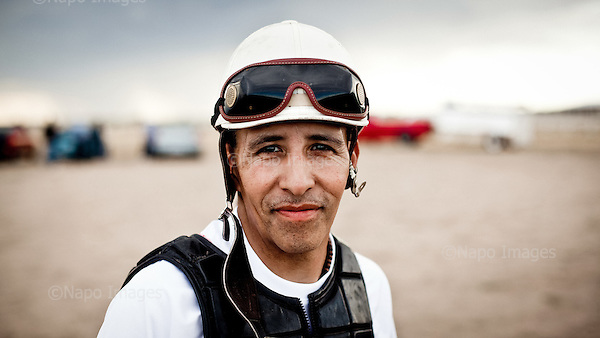 Dodge City, Kansas, USA, August 2011:.Mexican immigrant - jockey Ruperto Rosas poses during the horse racing event, one of the favourite past time for immigrant community. Many hispanic immigrants, mainly Mexican and Salvadorian came here to work at huge Cargill and National Beef meatpacking plants, each of which kills and processes 5-6 thousand cattle a day. Kansas dominates American beef industry, by producing one quarter of all beef in the USA, while being heavily dependent on cheap immigrant labour..(Photo by Piotr Malecki / Napo Images)..Dodge City, Kansas, Stany Zjednoczone, Sierpien 2011:.Meksykanski emigrant, dzokej Ruperto Rosas pozuje do zdjecia podczas wyscigow konnych, jednego z ulubionych sportow tutejszej spolecznosci emigrantow. Duzo emigrantow z Meksyku i Salwadoru pracuje w wielkich zakladach miesnych, ktore zabijaja i przerabiaja po 5-6 tysiecy sztuk bydla dziennie. Stan Kansas zdominowal rynek wolowiny w Stanach Zjednoczonych, produkujac jedna czwarta calej amerykanskiej wolowiny. Amerykanski przemysl miesny jest bardzo uzalezniony od taniej sily roboczej, ktora daja emigranci..Fot: Piotr Malecki / Napo Images.