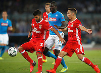 Calcio, Champions League: Napoli vs Benfica. Napoli, stadio San Paolo, 28 settembre 2016.<br /> Benfica's Lisandro Lopez, left, and Alex Grimaldo, right, and Napolis' Kalidou Koulibaly fight for the ball during the Champions League Group B soccer match between Napoli and Benfica at Naple's San Paolo stadium, 28 September 2016. Napoli won 4-2.<br /> UPDATE IMAGES PRESS/Isabella Bonotto