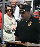 Saugerties Police Chief, Joseph A. Sinagra, visiting a booth at the Opening Day of the 2017 Saugerties Farmer's Market on Saturday, May 27, 2017. Photo by Jim Peppler. Copyright/Jim Peppler-2017.