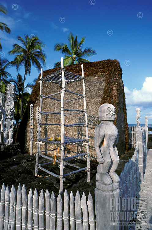 Hale o Keawe, a reconstructed temple, carved figures, and lele (offering platform) at Puuhonua O Honaunau National Historical Park (City of Refuge)