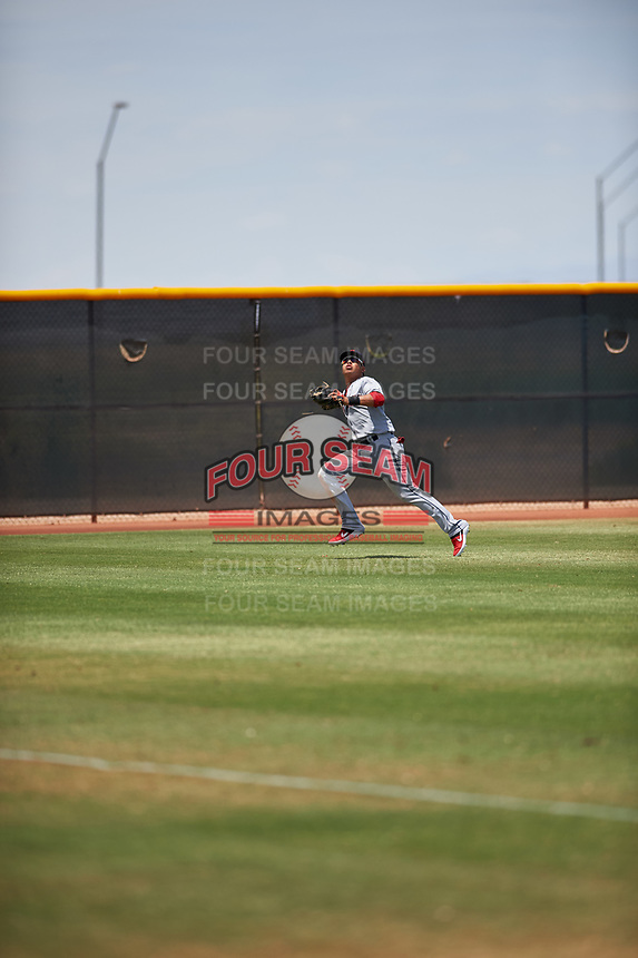 AZL Indians Red left fielder Cesar Idrogo (17) pursues a fly ball during an Arizona League game against the AZL Indians Blue on July 7, 2019 at the Cleveland Indians Spring Training Complex in Goodyear, Arizona. The AZL Indians Blue defeated the AZL Indians Red 5-4. (Zachary Lucy/Four Seam Images)