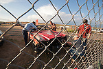 Crowds sit and watch the the stock-car destruction derby races the night before the annual Lind, Wash., Combine Destruction Derby.