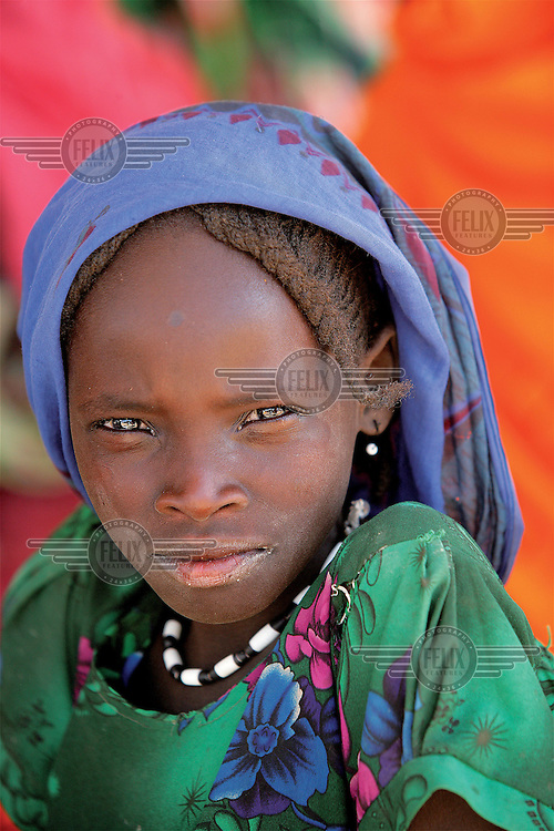 A portrait of a young girl at the Djabal refugee camp, a few kilometres outside Gozbeida. The camp is home to around 14,000 people, the vast majority of whom are Sudanese refugees from Darfur.