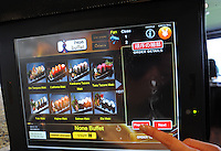 Customers order food in Hajime Restaurant from touch panel and Samurai robot waiter will bring ordered food to their tables, Bangkok, Thailand. Hajime is a Japanese restaurant in Thailand, has samurai style robot serving food to the diners and even do a dance session to entertain guests. This robot are made in Japan and costed about 86,600,000 yen (1,063,717USD). <br />