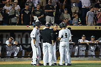 Wake Forest Demon Deacons head coach Tom Walter (center) gives instructions to his team in the bottom of the 9th inning during the game against the West Virginia Mountaineers in Game Four of the Winston-Salem Regional in the 2017 College World Series at David F. Couch Ballpark on June 3, 2017 in Winston-Salem, North Carolina.  The Demon Deacons walked-off the Mountaineers 4-3.  (Brian Westerholt/Four Seam Images)