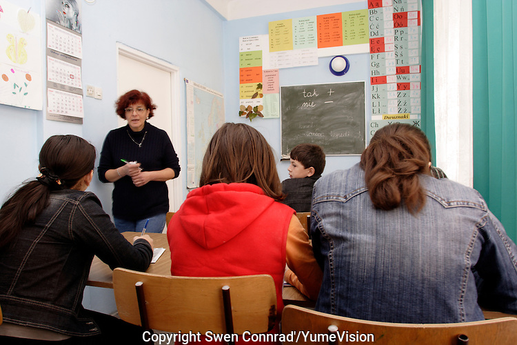 A class room with two boys and five girls learning to speak and basic grammatical polish language, in URiC Radom centre..-For security reason, the face of the adult asylum seeker have been evicted of the photography..-For security reason, the names of the adult asylum seeker have been change. .-Article 9 of the Act of 13 June 2003 on grating protection on the Polish territory (Journal of Laws, No 128, it. 1176) personal data of refugees are an object of particular protection..-Cases where publication of a picture or name of asylum seeker had dramatic consequences for this persons and is family back in Chechnya. .Please have safety of those people in mind. Thank you.