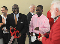 Sherman Tate, board chairman of the Urban League of Arkansas (second from left), and D'Andre Jones, board member (fourth from left), conclude a ribbon-cutting ceremony Friday Sept. 18 2015 for the Springdale office of the Urban League of Arkansas. The office is in the Center for Nonprofits, 614 E. Emma Ave.
