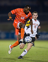 Phanuel Kavita (18) of Clemson takes control of the ball in front of Patrick Mullins (15) of Maryland during the game at the Maryland SoccerPlex in Germantown, MD. Maryland defeated Clemson, 1-0, in overtime.  With the win the Terrapins advanced to the finals of the ACC men's soccer tournament.
