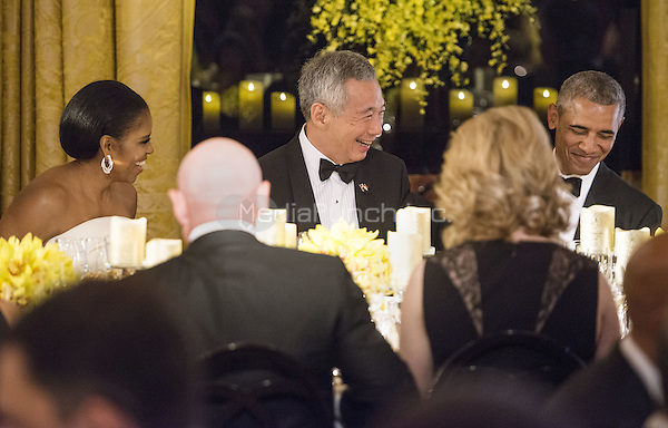 United States President Obama, First Lady Michelle Obama, and Prime Minister Lee Hsien Loong laugh during the State Dinner in the East Room of the White House in Washington, DC on Tuesday, August 2, 2016. <br /> Credit: Leigh Vogel / Pool via CNP/MediaPunch
