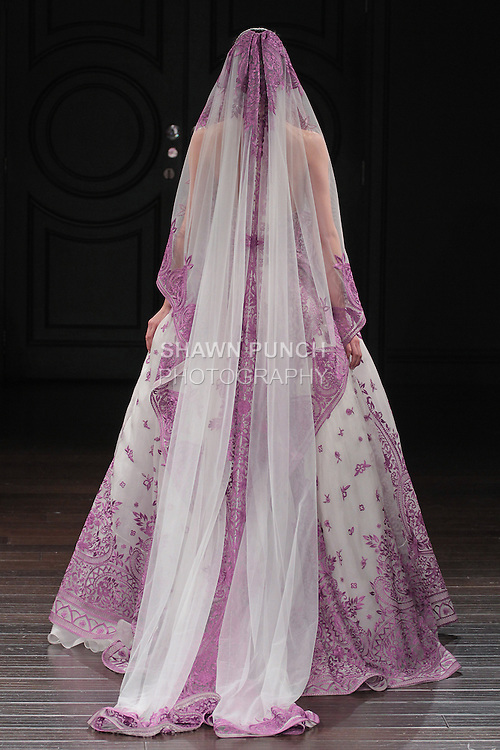 Model walks runway in a Doha bridal gown from the Naeem Khan Bridal Spring 2017 collection at 260 West 36 Street, during New York Bridal Fashion Week Spring Summer 2017 on April 16, 2016.