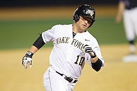 Nate Mondou (10) of the Wake Forest Demon Deacons rounds the bases after hitting a 2-run home run in the bottom of the 8th inning against the High Point Panthers at Wake Forest Baseball Park on April 2, 2014 in Winston-Salem, North Carolina.  The Demon Deacons defeated the Panthers 10-6.  (Brian Westerholt/Four Seam Images)