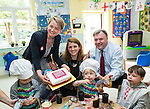 © Joel Goodman - 07973 332324 . 14/06/2016 . Burnley , UK . Yvette Cooper MP , Alison McGovern MP and Ed Balls pose with a Vote Remain cake whilst campaigning for Remain , in the EU referendum , at Giant Leap Child Care and Learning House in Burnley . Photo credit : Joel Goodman