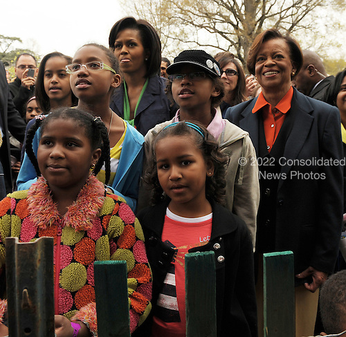 Washington, DC - April 13, 2009 -- Sasha Obama (bottom right), Malia Obama (top left), First Lady Michelle Obama (top center), her mother Marian Robinson (right) and other guests watch as Fergie performs during the annual Easter Egg Roll on the South Lawn of the White House in Washington on April 13, 2009.  .Credit: Roger L. Wollenberg - Pool via CNP