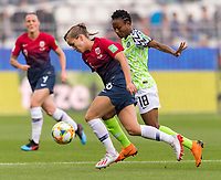 REIMS, FRANCE - JUNE 08: Guro Reiten #16 dribbles past Halimatu Ayinde #18 during a game between Norway and Nigeria at Stade Auguste-Delaune on June 8, 2019 in Reims, France.
