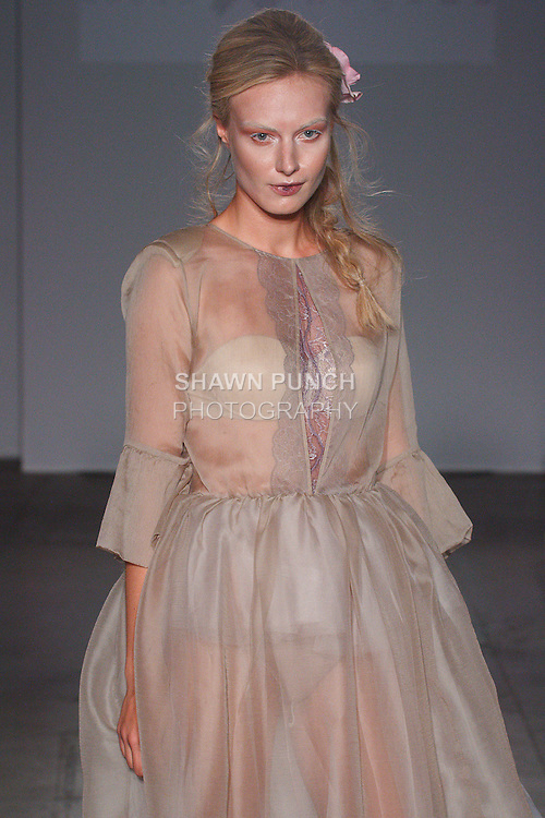 Model walks runway in an outfit from the Dorin Negrau Spring Summer collection, during New York Fashion Week Spring 2016.