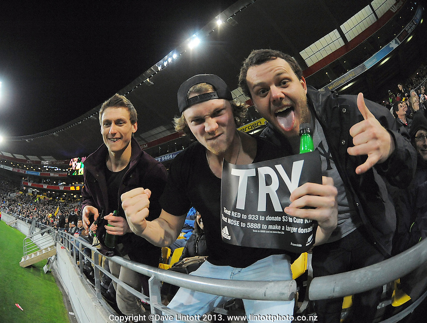 Fans celebrate during the Rugby Championship international rugby Bledisloe Cup test match between All Blacks and Australia at Westpac Stadium, Wellington, New Zealand on Saturday, 24 August 2013. Photo: Dave Lintott / lintottphoto.co.nz