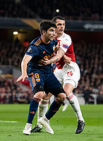 Valencia Carlos Soler and Arsenal's Granit Xhaka during the UEFA Europa League Semi-Final 1st leg match between Arsenal and Valencia at the Emirates Stadium, London, England on 2 May 2019. Photo by Andrew Aleksiejczuk / PRiME Media Images.