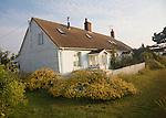 Homes at the coastal hamlet of Shingle Street, Suffolk, England