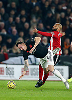 24th November 2019; Bramall Lane, Sheffield, Yorkshire, England; English Premier League Football, Sheffield United versus Manchester United; Phil Jones of Manchester United falls to floor as his is challenged by David McGoldrick  of Sheffield United - Strictly Editorial Use Only. No use with unauthorized audio, video, data, fixture lists, club/league logos or 'live' services. Online in-match use limited to 120 images, no video emulation. No use in betting, games or single club/league/player publications