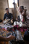 Ankur Malhotra (not in picture) is doing the field recording of the performance of 66-year-old Manganiyar artist, Lakha Khan (right) and his eldest son, Dane Khan (left) in their house in Raneri village of Jodhpur district in Rajasthan, India. Photo: Sanjit Das/Panos