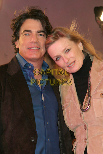 "PETER GALLAGHER & GUEST.""VH1 Big In '05 Awards"" - Arrivals held at Sony Studios, Culver City, California..December 3rd, 2005.Photo: Zach Lipp/AdMedia/Capital Pictures.Ref: ZL/ADM.half length head on shoulder.www.capitalpictures.com.sales@capitalpictures.com.© Capital Pictures."
