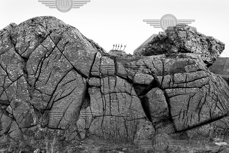 Remnants of defensive structures used by the German Army are visible along a rocky coast in Norway along the route of the Atlantic Wall (Atlantikwall in German).The Atlantic Wall (or Atlantikwall in German) was a system of defensive structures built by Nazi Germany between 1942 and 1945, stretching over 1,670 miles (2,690 km) along the coast from the North of Norway to the border between France and Spain at the Pyrenees. The wall was intended to repulse an Allied attack on Nazi-occupied Europe and the largest concentration of structures was along the French coast since an invasion from Great Britain was assumed to be most likely. Slave labour and locals paid a minimum wage were drafted in to supply much of the labour. There are still thousands of ruined structures along the Atlantic coast in all countries where the wall stood except for Germany, where the bunkers were completely dismantled.