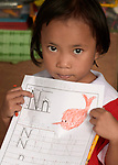 A girl shows off her class work featuring the letter N in a preschool sponsored by the Kapatiran-Kaunlaran Foundation (KKFI) in Pulilan, a village in Bulacan, Philippines.<br /> <br /> KKFI is supported by United Methodist Women.